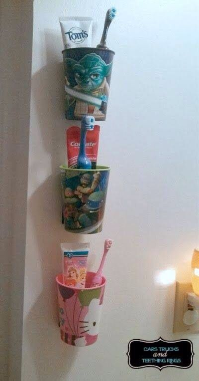 I like this idea about having each child's tooth care items together. That way they won't get them mixed up...but probably hung in cabinet under sink not out