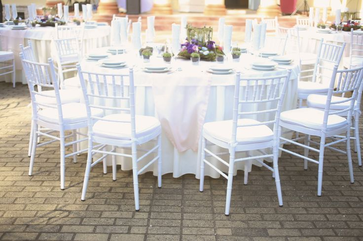 Snow white chiavari chairs for wedding reception - Looks amazing in the photos and you don't have to spend on dressing up the chairs