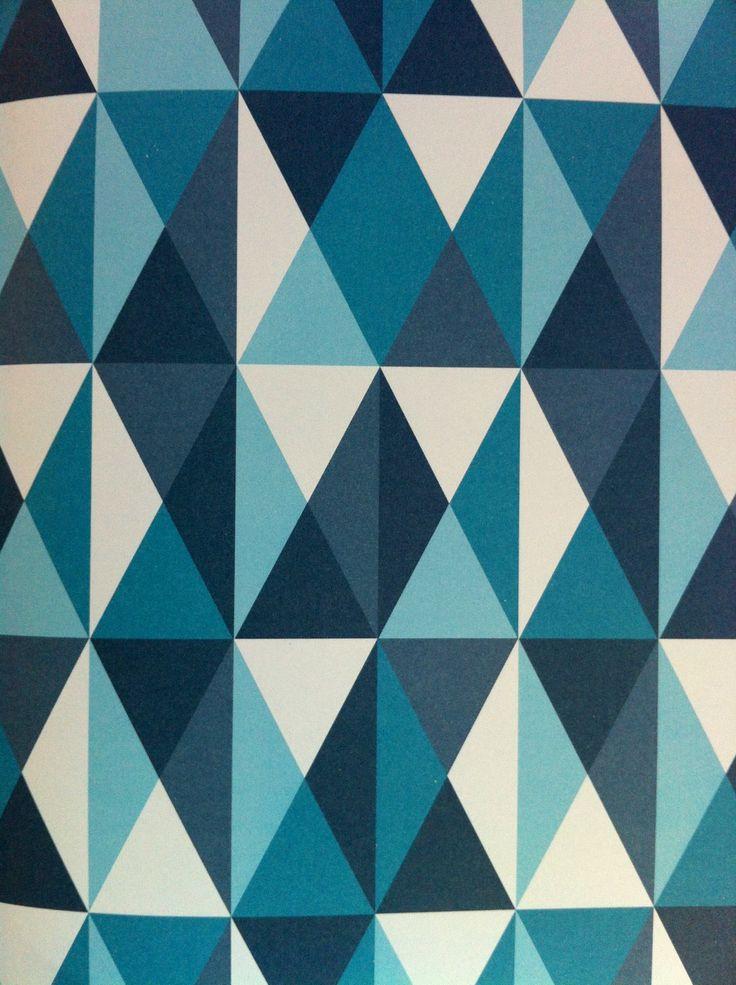 Gorgeous geometrics.  http://www.wallpaperdirect.com/products/prestigious/link-flock-onyx/100716 or http://www.wallpaperdirect.com/products/neisha-crosland/zebra-brown-silver/67806