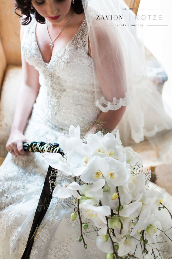 How gorgeous is this bridal bouquet!Gatsby inspired wedding with black and white décor. White roses and white orchids. Black tiffany chairs, Great Gatsby, rare wedding, special wedding, wedding of the year. White flowers, white mass arrangements, white floral arrangement, candle light.  Bride, bridal bouquet, bridal flowers, bride bouquet.