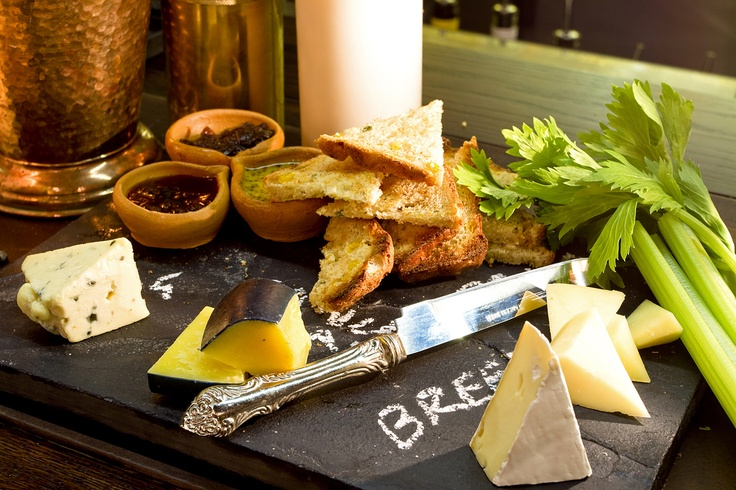 Orphanage Cheese Slate :   Selection of four local artisan cheeses, caramelised onion, citrus mustard, sweet harrief & wood fired corn-bread.