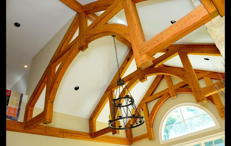 Jason Newberry of Legacy Wood Products in Watkinsville designed the modified hammer-beam truss ceiling and installed it. They used beams from an old warehouse in downtown Atlanta that Barber believes dates to the 1860s. The chandelier was sourced from Design Lighting Group.