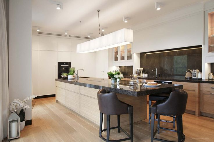 Wooden and marble kitchen, illuminated with white Erubo spotlights on the ceiling.
