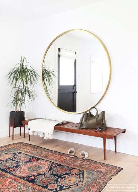 Round mirror in hallway <3