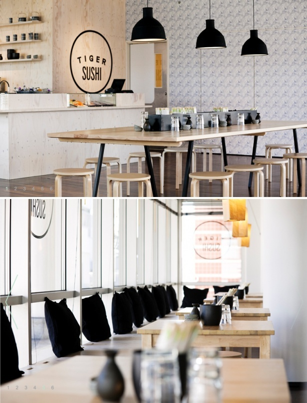 Located in Keilaniemi, just outside of Finland's capitol Helsinki. Tiger Sushi, designed by Joanna Laasjisto, features a soft Scandinavian palette perfectly offset by black accents.