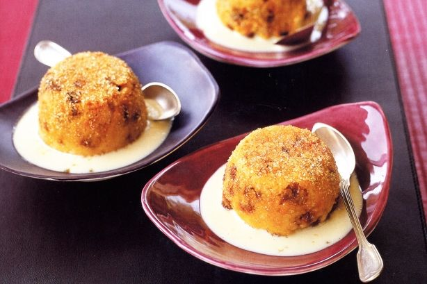 Bathing in pools of custard, these quintessentially British sugar-dusted puddings are pure comfort.
