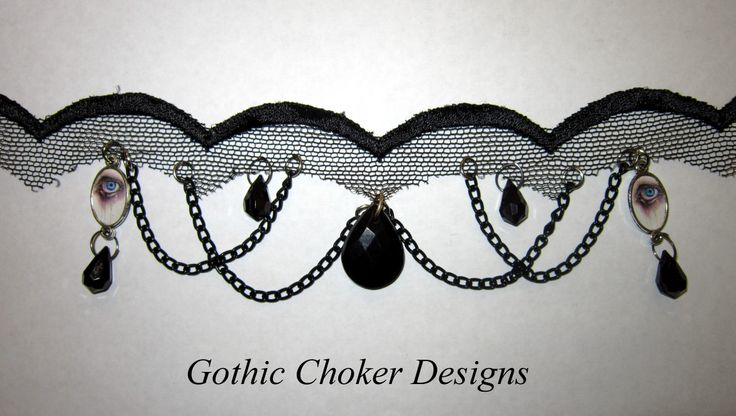 Black mesh choker with black acrylic crystals, black chains and a printed eye cameo on each side. R150 approx $15. Purchase here: https://hellopretty.co.za/gothic-choker-designs/black-mesh-choker-with-chains-crystals-and-eye-cameos