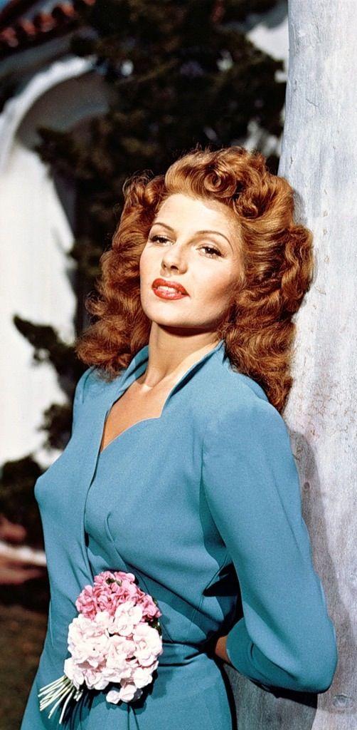 Rita Hayworth color portrait movie star 40s glamorous photo print ad blue day dress wrap vintage fashion style flower corsage