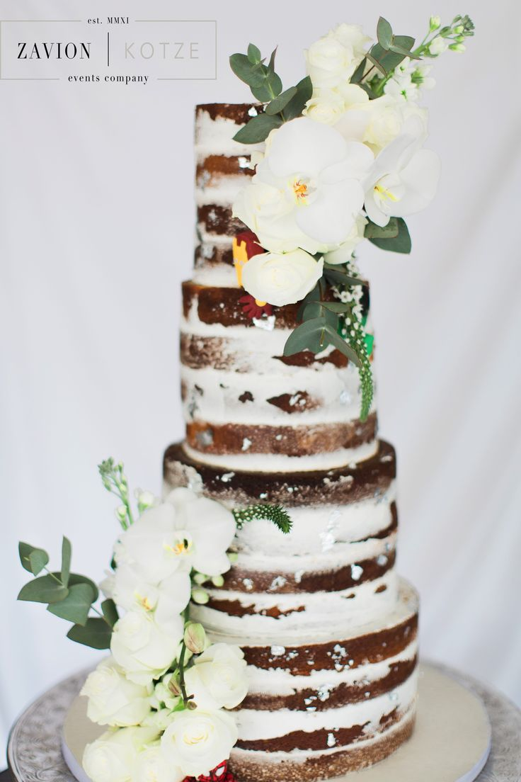 Incredible wedding cake by Kelly Jaynes. Have a look at their website - You cannot ever go wring with them- they are AMAZING at what they do. www.kellyjayne.co.za