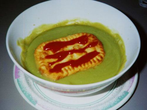 A pie floater is available in Adelaide, South Australia. It consists of the traditional Australian style meat pie sitting, usually inverted, in a plate of steaming thick green pea soup, covered with tomato sauce, subject to individual vagaries of taste of the consumer, salt and pepper added. As the Town Hall Clock strikes midnight, pie floater mavins clad in rags, or others in more formal attire, stand side-by-side under the pie cart awning, tasting Heaven from a chipped and stained bowl.