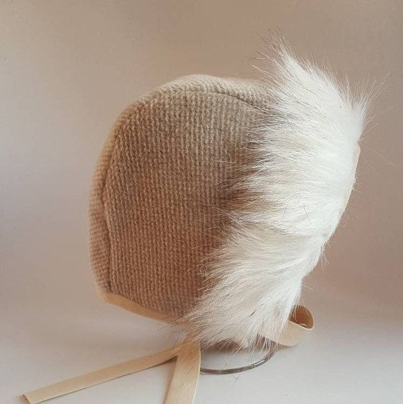 Cashmere baby bonnet Each and every bonnet is made with love and care! Hand cut and hand crafted with 70% cashmere and 30% wool fabric and cozy flannel lining, trimmed in faux fur. Liner of the bonnet is made by 100% cotton fabric. # CARE # May be washed with cold water on Delicate cycle.