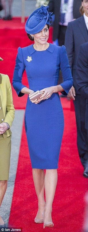 DRESS: Jenny Packham bespoke design STYLE: Long lean and fitted  DETAILS: Collar front and back BAG: Elegant pink clutch SHOES:£495 beige heels from Gianvito Rossi  HAIR : Elaborate chignon HAT: Stunning Lock & Co saucer with a customised maple leaf
