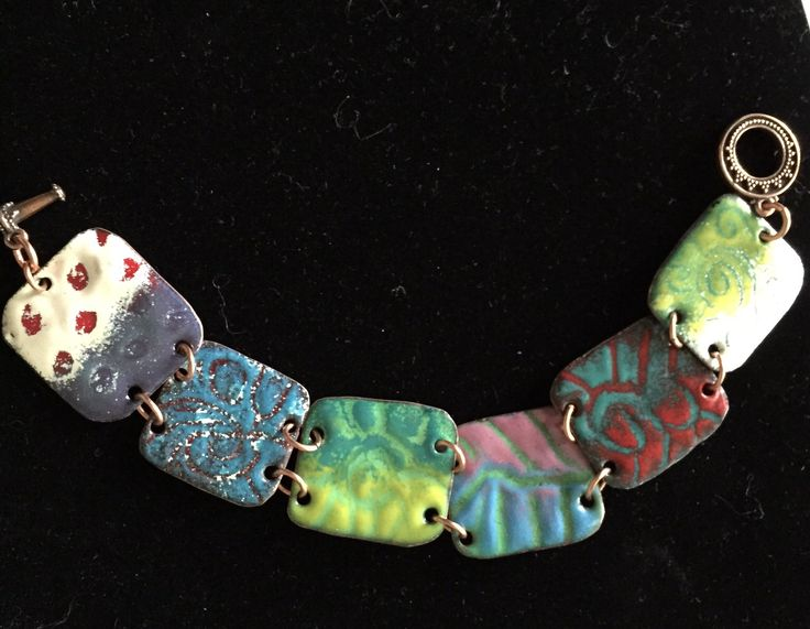 "Torch fired enamel on copper using the ""sgraffito"" technique."