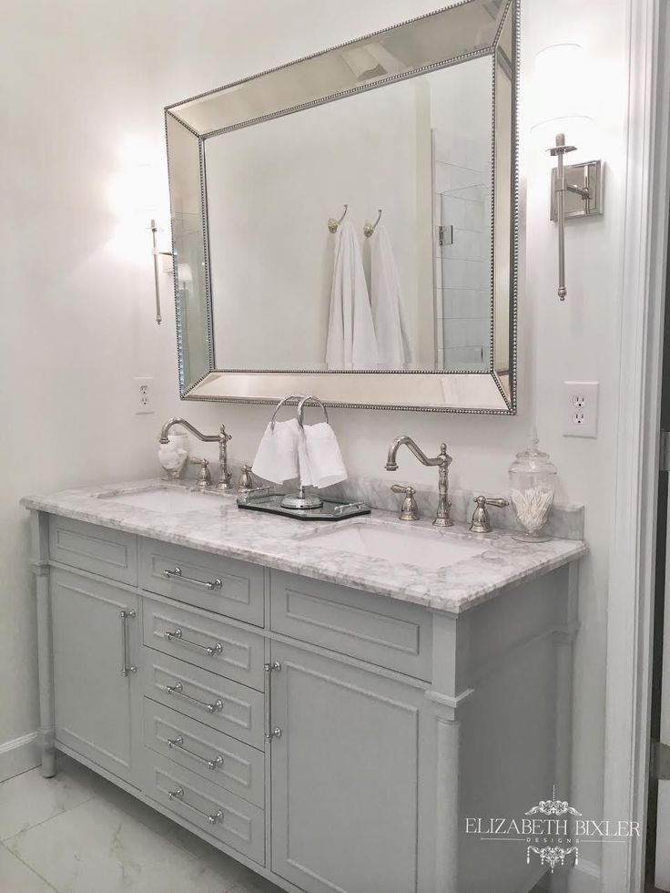 white master bathroom with vintage faucets