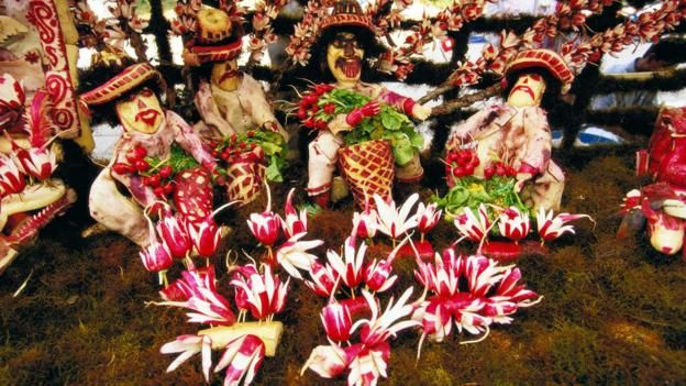 Noche de Rabanos, or Night of the Radishes, is a tradition stretching back more than a century Merchants hoping to attract potential shoppers to the zócolo (town plaza) before and after Christmas church services would carve intricate shapes into the radishes' ruby skin, sometimes forming little people or decorating the carving with other vegetables for sale. The festive radishes were a hit: locals bought the most intricate offerings for their Christmas centrepieces.
