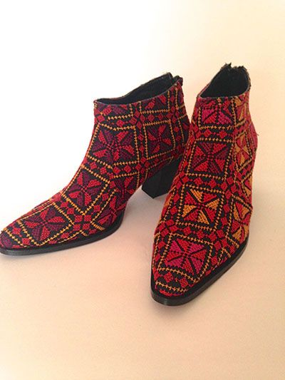 Cowboy style shoes shoes, handmade, using a traditional Palestinian embroidery technique.