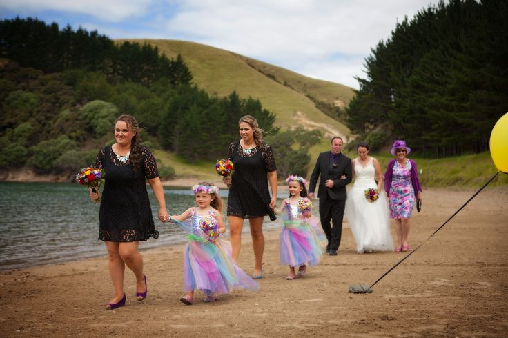 The arrival of this beautiful bride and the couples children reduced the groom to tears at Whangaihe bay wedding with Susi Liddington Creative. www.susiliddington.com www.jennayoungphotography.co.nz