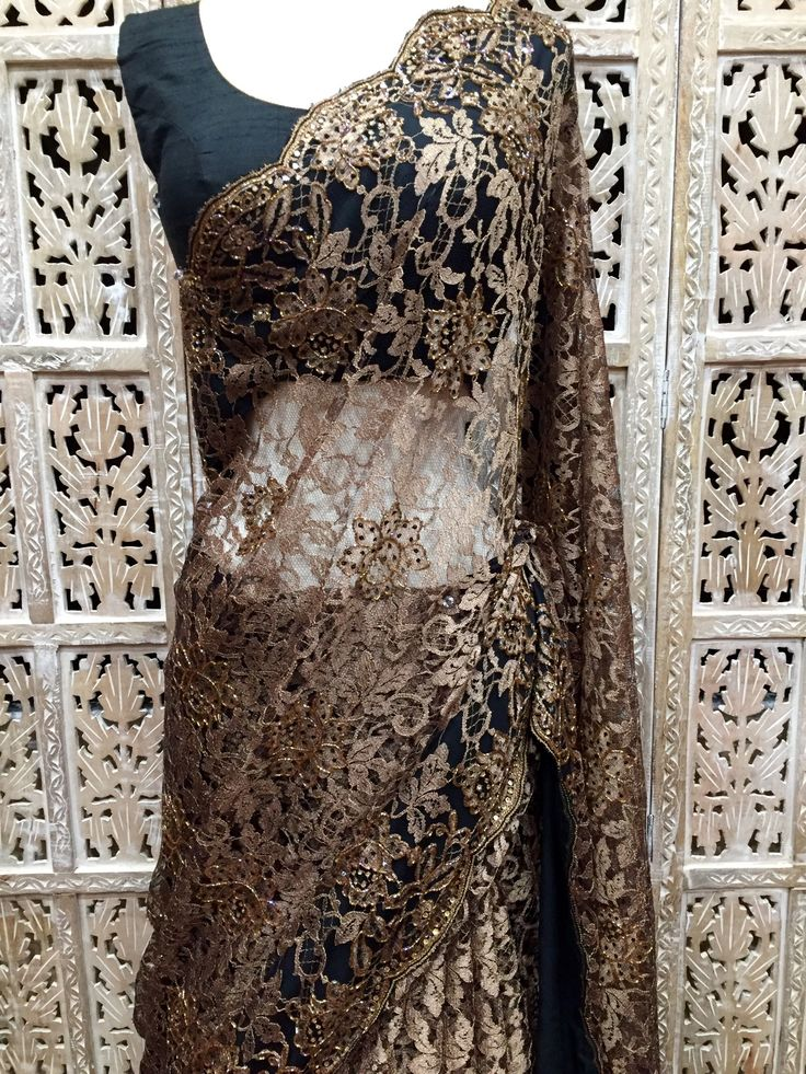 Antique gold French Chantilly lace saree embellished with crystals, beads and sequins. Custom orders available. Colors and designs avaialbe. Please contact www.riitifashions.com 408-368-8486
