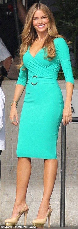 Enchanting: Sofia Vergara showed off her curves in a teal dress on set of Chef shooting in Miami, Florida, on Monday