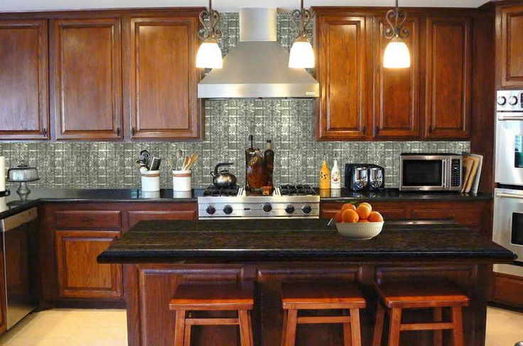 Pressed Tin Panel Kitchen Splash Back the silver is a great contrast to the warm timber