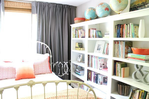 wall o' drapes and fabulous bookshelves - from The Inspired Home