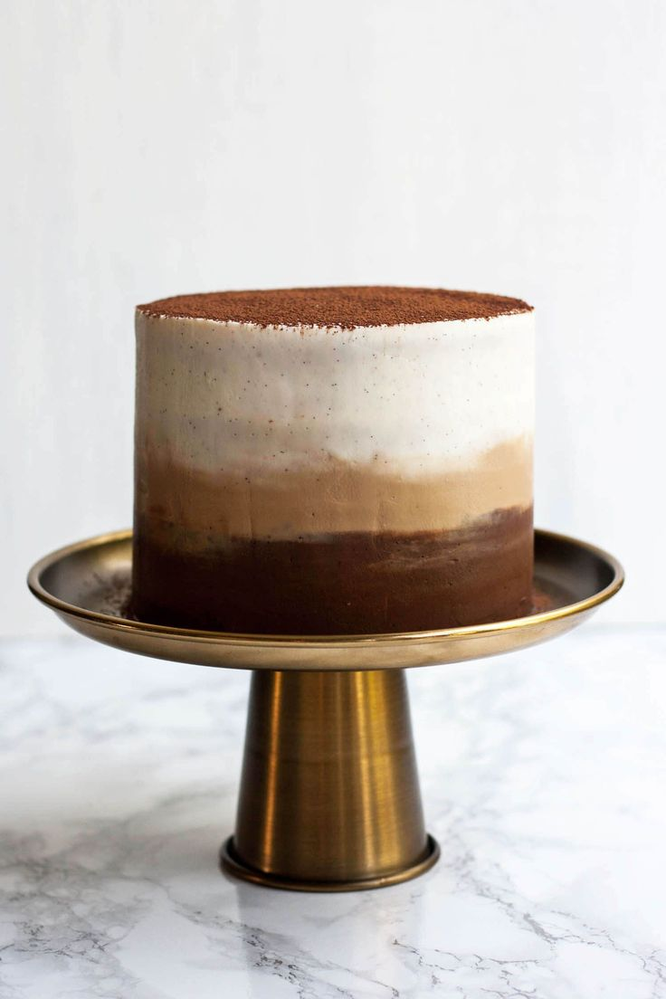 """This coffee flavored cake is covered in creamy mascapone frosting. Get the recipe <a href=""""http://www.eatloveeats.com/tiramisu-layer-cake-ombre-mascarpone-frosting/""""><strong>HERE</strong></a>."""