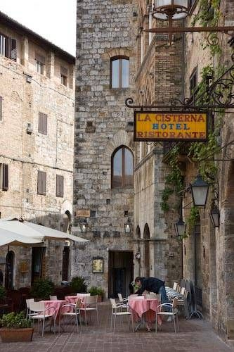 Picture of Piazza della Cisterna in San Gimignano...  The cistern in Piazza della Cisterna is a meeting point for young people on tour in San Gimignano. Shops, restaurants and gelaterie line the triangular square.