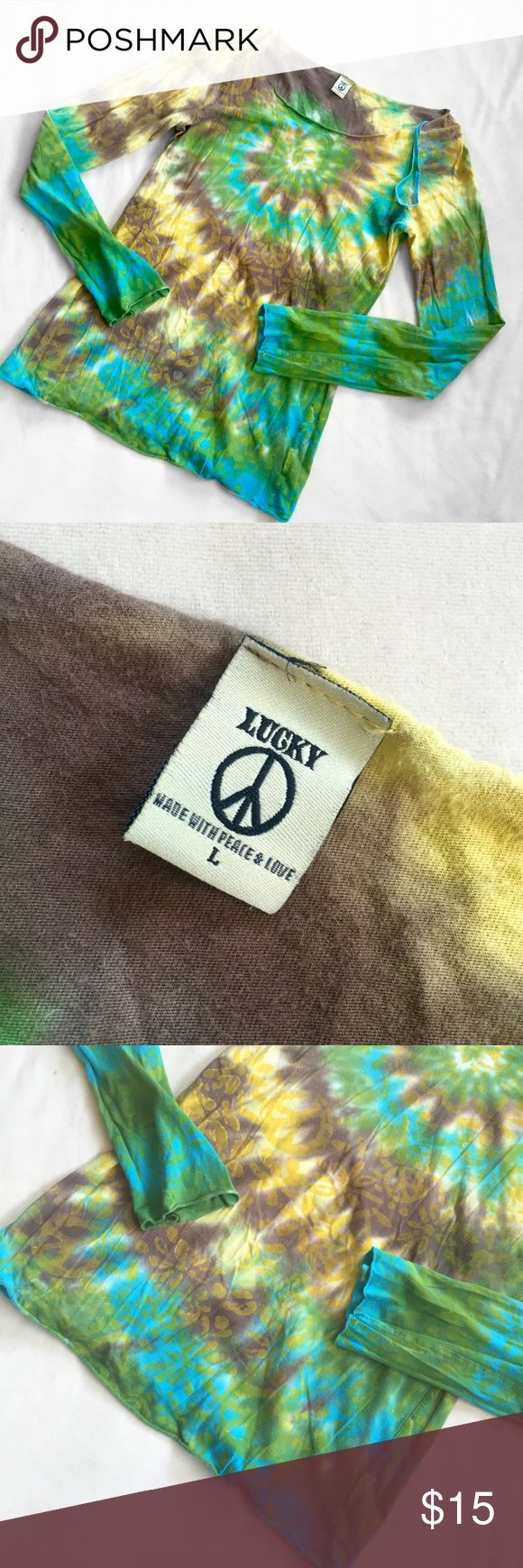 "Lucky Brand Peace & Love Tie Dye Long Sleeve Top Lucky Brand • Size Large • 100% cotton • Turquoise, chestnut brown, green, and pastel yellow tie dye with yellow flower and peace sign patterns printed on top • Raw hems • Armpit to armpit: approx. 18.5"" straight across. Sleeve inseam: 20.5"" long. • Minor pilling from wear, but no major damage. Tiny, tiny little stain, but it's barely noticeable due to the pattern (shown in last photo) Lucky Brand Tops Tees - Long Sleeve"