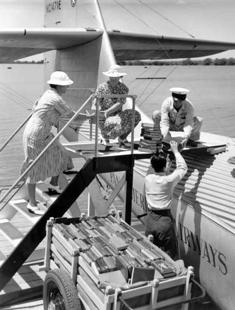 "Library of Hawaii and Pan American staff load books onto the ""China Clipper"" for delivery to Midway and Wake Islands."