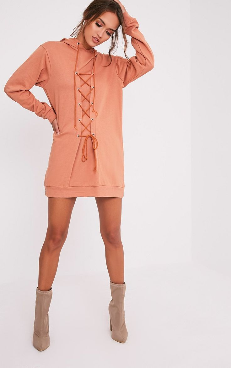 Deep Peach Lace Up Hooded Sweater DressChannel that off-duty style this  season in this sweater dr.