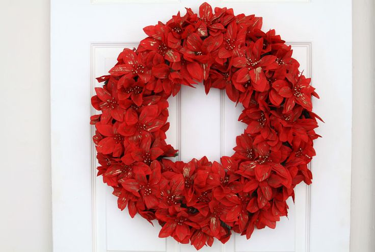 Remake Poinsettias, the fleur du jour during the holidays, by wrapping the silk flowers into a wreath and hanging it around the house.  Get how-to instructions.  Wreath courtesy of WeLoveWreaths.com. Similar wreaths may be purchased ready-made through the site.