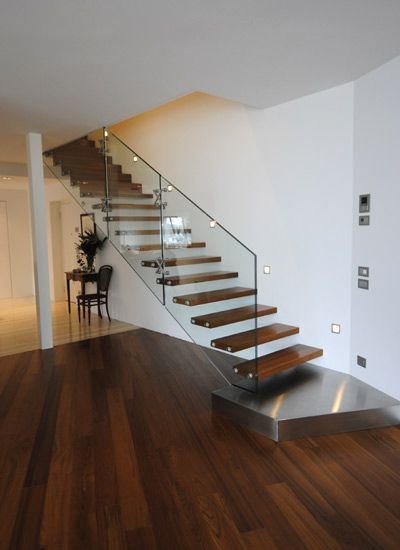 Floating stairs - dark wood and less in wall
