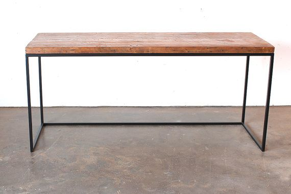 SIMPLE SLAB DESK WITH STEEL BASE Simple. Slick. Classic. The rest you can see for yourself. The Reclaimed Fir is finished in a hand-rubbed wax,