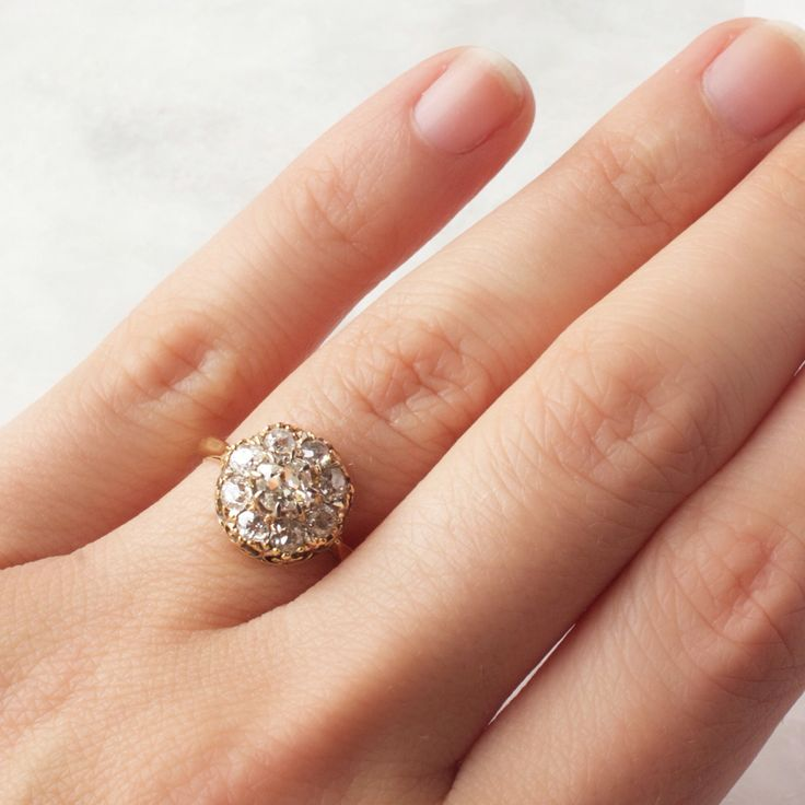 Victorian cluster vintage engagement ring with old mine cut diamonds!