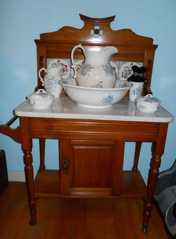 """Beautiful washstand with flawless wood, marble top, and lovely tile backing. I used to think I wanted a washstand porcelain set like this, as """"country"""" as it seems, but never bought one. This complete set is pretty."""