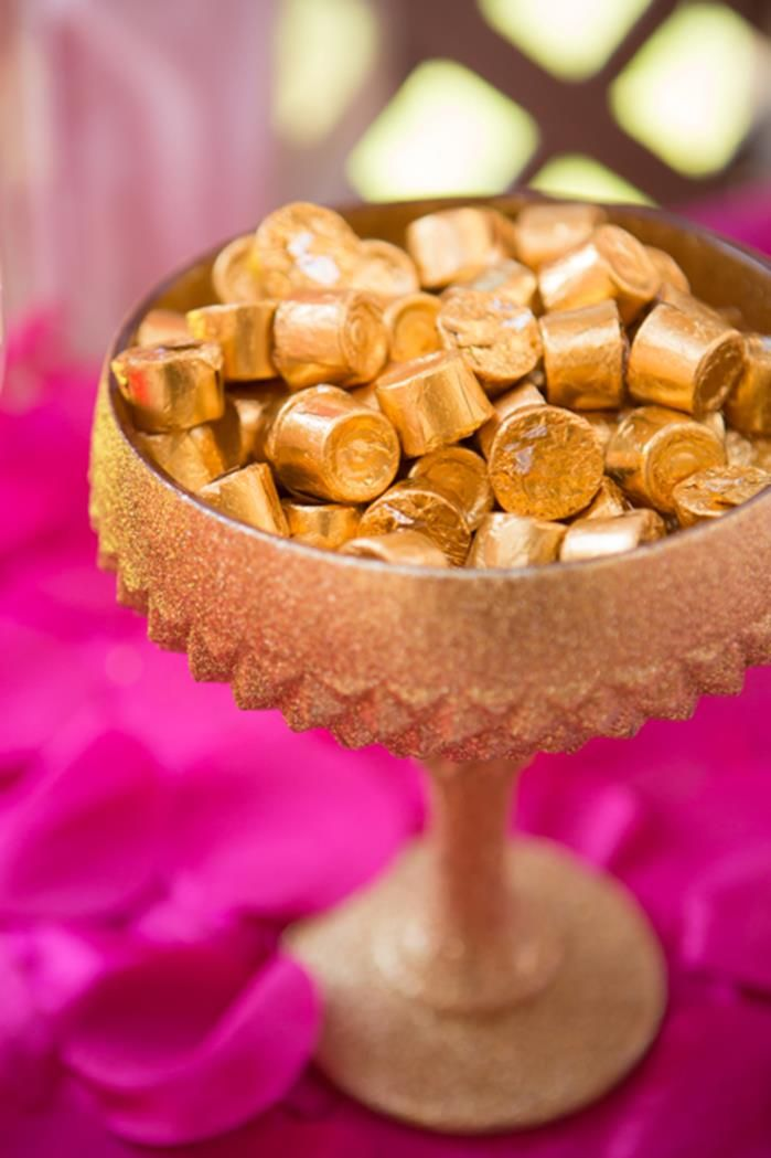 "spray paint old vases with gold paint and fill them with foil covered candies for a ""royal"" treat"