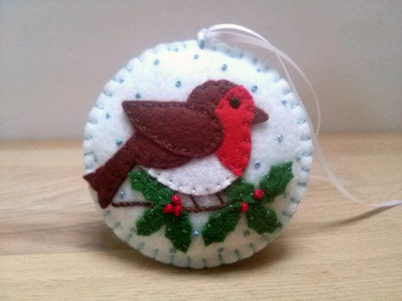Felt christmas ornament - robin bird / wool blend felt/ white background  This listing is for 1 ornament  Size about 8 cm Material wool blend felt  Handmade from felt with high precision and great care Please note that ornaments are decorated on one side only. Other side is solid white. This is made to order item.  For more Christmas ornaments visit my Christmas section https://www.etsy.com/shop/DusiCrafts?section_id=15537694…