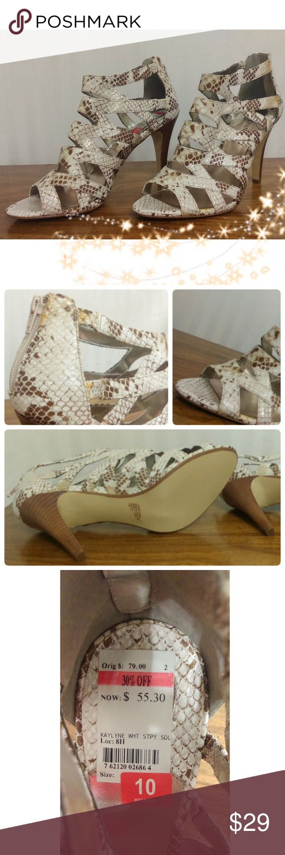 New Alfani Animal Print High Heels Gorgeous Alfani Animal Print White & Brown High Heels. Measurements: 4.5 inches Heel Width: Medium Material: Leather I bought them but never worn them. Beautiful Heels! (Do not include original box).   🛍10% OFF 2+ Bundle! 📦I ship same or next day! 🚭From a smoke free home. Alfani Shoes Heels