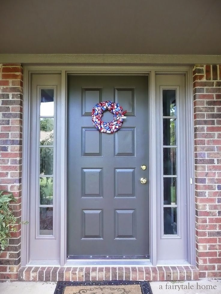 Exterior Paint Colors to go with red brick Door-sealskin, trim-backdrop by Sherwin Williams