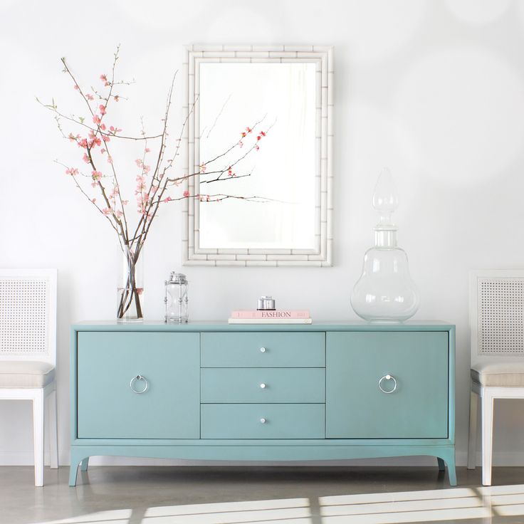 The Redford House collection of furniture and home decor reproductions marries style and function. Lovely in transitional living rooms, the Fiona entertainment console exudes simple sophistication. Atop exposed legs, this timeless wood chest features three glide drawers for practical electronic storage. Opening with metal pulls, two doors conceal two adjustable shelves. Shown in Robin's Egg blue with light distressing and chrome pulls, this furnishing is available in several finish and ha...