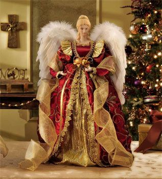 Beautiful angel tree topper with gold and red.