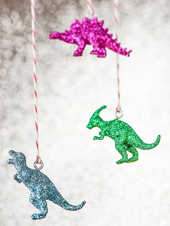 It's easy to turn plastic dinosaur toys into Jurassic jewels to hang as ornaments from your Christmas tree. Just add glitter!