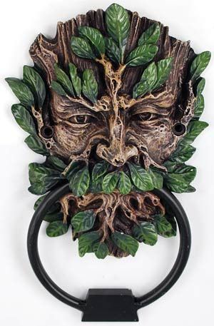 "This unique and lovely piece captures the traditional image and placement of the Greenman and brings him into your home as this ornamental door knocker. Sculpted of cold cast resin, the door knocker beautiful portrays the face of the Greenman as a weathered and gnarled tree stump, with verdant green leaves sprouting to form his beard, hair, and eyebrows. This door knocker hangs 7"" long and 4"" wide.   ONLY $19.95"