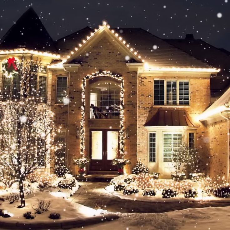 Image result for christmas lights on house two story arch