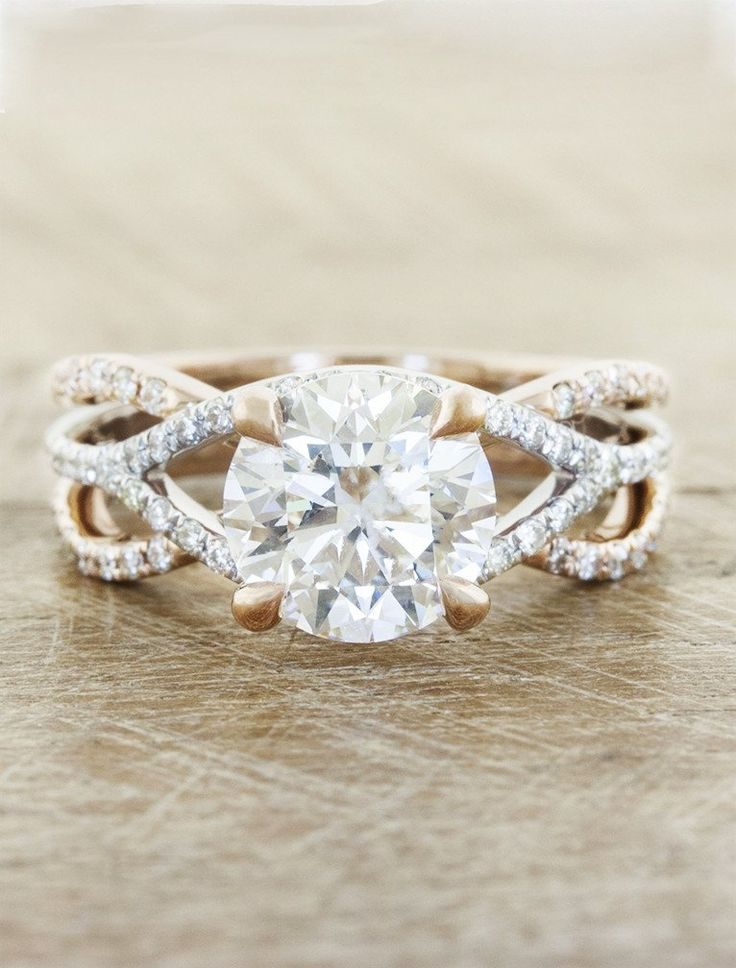 The Jasmine blends rose gold and platinum for a truly unique engagement ring. A round cut diamond is set in a classic 4-prong setting, but surrounded by vine-like tendrils and rare pink diamonds.