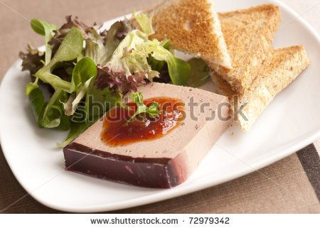 Duck liver, Sauternes and truffle parfait with salad and toasts - stock photo