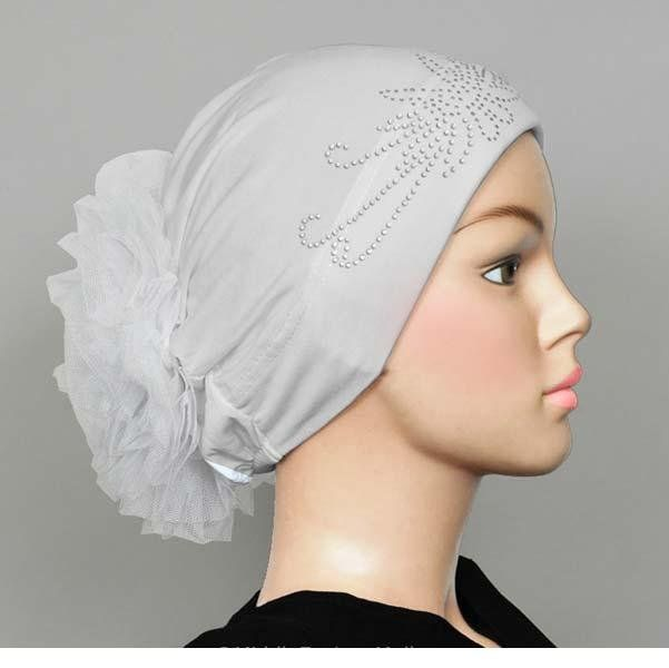 #HijabStyle Volume Hijab Cap in White. Perfect for creating voluminous hijab styles without using a poof hairband or clip that can pinch and slip. Perfect for everyday.