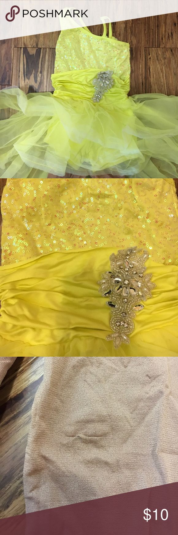 Dance costume yellow sequin dress and tights This is a bundle of a dress and a pair of nude tights. This can be worn for a fun dress up play or a Halloween costume. The dress has a tule skirt with attached shorts underneath. It's stretchy, but I'd suggest it would best fit a 3-5 y.o. Both of these have only been worn twice (dressed rehearsal and recital). The tights have a tiny pull (see pic) that's not really noticeable when worn. Dresses