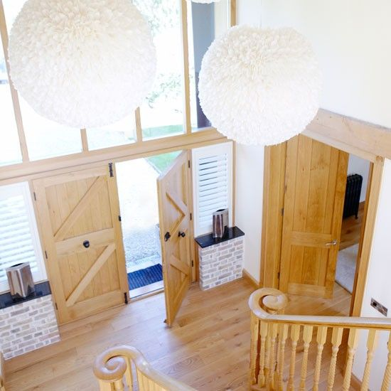 Open up the space A double height hallway creates a light-filled atrium for this barn conversion. Decorative finishes are kept to a minimum in order not to detract from the space, while huge fluffy feather ball lights provide the impact. Similar wood flooring The New England Shutter Company Similar lights Leigh Harmer  Read more at http://www.housetohome.co.uk/room-idea/picture/country-hallway-ideas-10-of-the-best/3#RKRcGPHQ5ccArcHW.99