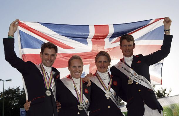 Zara Phillips celebrates team silver with Harry Meade, Kristina Cook and William Fox-Pitt
